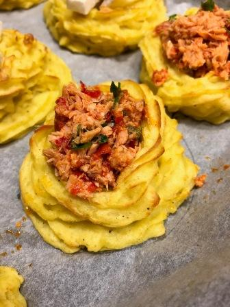 Ready to eat, my spicy tuna potatoes nests.